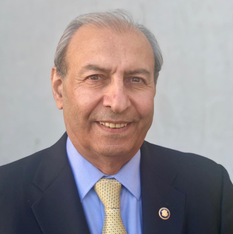 Dr. Reza Karkia